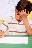 Little boy has troubles with homework royalty free stock images