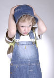 Little boy with hat. Little boy looking downwards Stock Photo