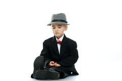 Little boy in hat and black suit Stock Image