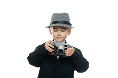 Little boy in hat and black suit Stock Photography