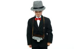 Little boy in hat and black suit Stock Images
