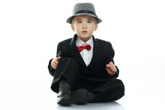 Little boy in hat and black suit Stock Photo
