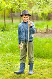 Little boy in hat and boots outdoor Stock Images