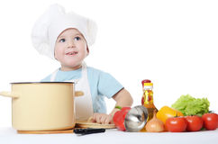 The little boy in a hat of the cook Royalty Free Stock Image