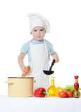 The little boy in a hat of the cook Stock Photography