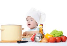 The little boy in a hat of the cook Stock Images