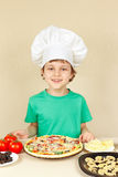 Little boy in hat cook with cooked homemade pizza Stock Image
