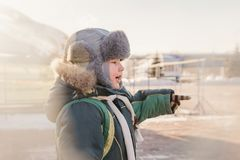 Small child in a fluffy Hat ear flaps, winter stock images