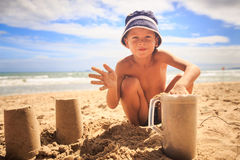 Little Boy in Hat Makes Sand Cake with Plastic Mug Stock Images