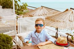 Little boy in shirt and shorts on the beach sand. Little boy hav Royalty Free Stock Photography