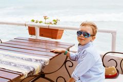 Little boy in shirt and shorts on the beach sand. Little boy hav Stock Photography