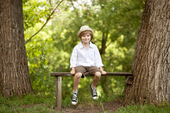 Little boy in a hat, shorts. And sneakers Royalty Free Stock Photography