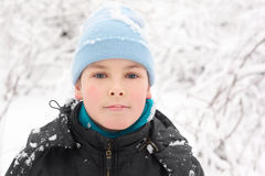 Little boy in hat with snow Stock Photo