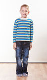 Little boy have fun alone at home. Stock Images