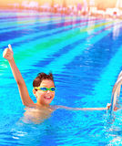 Little boy have fun in the pool Royalty Free Stock Image
