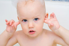 Little boy having a bath with soap foam Royalty Free Stock Image