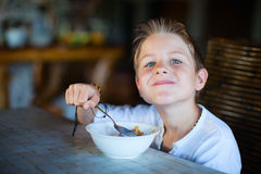 Little boy having breakfast Stock Image