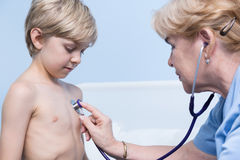 Little boy having examination Royalty Free Stock Photos