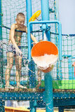 Little boy having fun in aqua park. With water bucket Royalty Free Stock Images