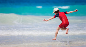 Little boy having fun at beach Royalty Free Stock Images