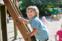 Little boy having fun on city playground on sunny day Royalty Free Stock Photography