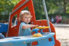 Little boy having fun on city playground on sunny day Royalty Free Stock Photos