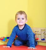Little boy having fun in daycare Royalty Free Stock Image