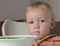 Little boy. Having fun eating his cereal Stock Photography