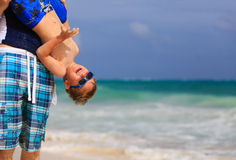 Little boy having fun with father on summer beach Royalty Free Stock Images