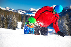 Little boy having fun with his caucasian attractive father durin. G skiing in Alps Royalty Free Stock Photography