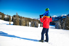 Little boy having fun with his caucasian attractive father durin. G skiing in Alps Royalty Free Stock Photo