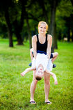 Little boy having fun with his mother. In a park during beautiful summer evening Stock Images