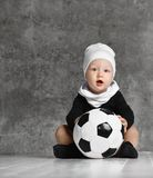 Cute image of baby holding a soccer ball royalty free stock photography