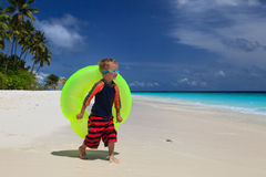 Little boy having fun with inflatable ring Royalty Free Stock Photos