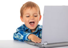 Little boy having fun with laptop Stock Photos