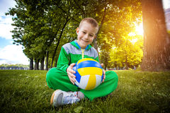Little boy having fun playing soccer with ball Stock Images