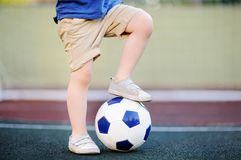 Little boy having fun playing a soccer/football game on summer day Royalty Free Stock Photography