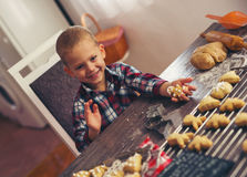 Little boy having fun in preparing Christmas cookies Royalty Free Stock Photography