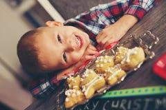 Little boy having fun in preparing Christmas cookies Royalty Free Stock Image