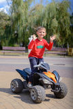 Little boy having fun on a quad bike Stock Images