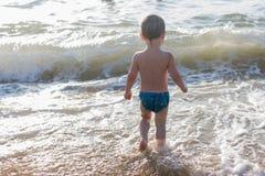 Little boy having fun in the sea Stock Photos