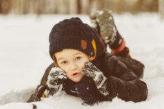 Little boy having fun in the snow Royalty Free Stock Image