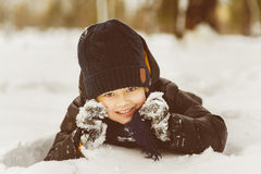 Little boy having fun in the snow Stock Photos