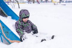Little boy having fun in the snow Stock Image