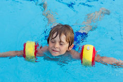 Little boy having fun in an swimming pool Royalty Free Stock Photography