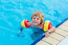 Little boy having fun in an swimming pool Royalty Free Stock Image