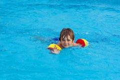 Little boy having fun in an swimming pool Royalty Free Stock Photo