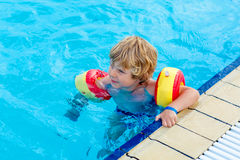 Little boy having fun in an swimming pool Royalty Free Stock Photos