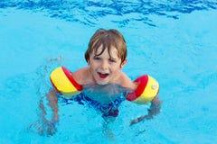 Little boy having fun in an swimming pool Stock Photography