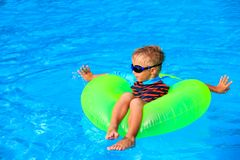 Little boy having fun in the swimming pool Royalty Free Stock Photos